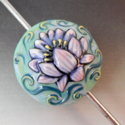 Lentil Shape Hollow Focal Bead with Raised Lotus Design